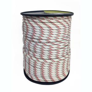 szpula białej liny z czarno-czerwonymi kontrolkami
